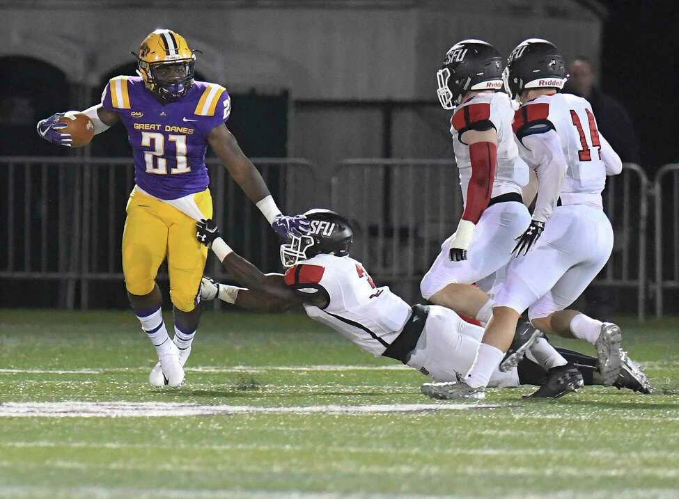 University at Albany running back Karl Mofor (21) runs with the ball against St. Francis during the first half of an NCAA college football game Saturday, Sept. 22, 2018, in Albany, N.Y.