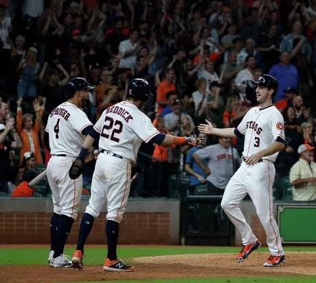Houston Astros Kyle Tucker (3) celebrates his run scored with Josh Reddick (22) and George Springer (4) during the eighth inning of an MLB baseball game at Minute Maid Park, Saturday, September 22, 2018, in Houston.