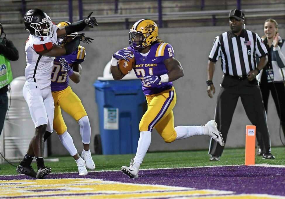 University at Albany running back Karl Mofor (21) scores a touchdown against St. Francis during the first half of an NCAA college football game Saturday, Sept. 22, 2018, in Albany, N.Y.
