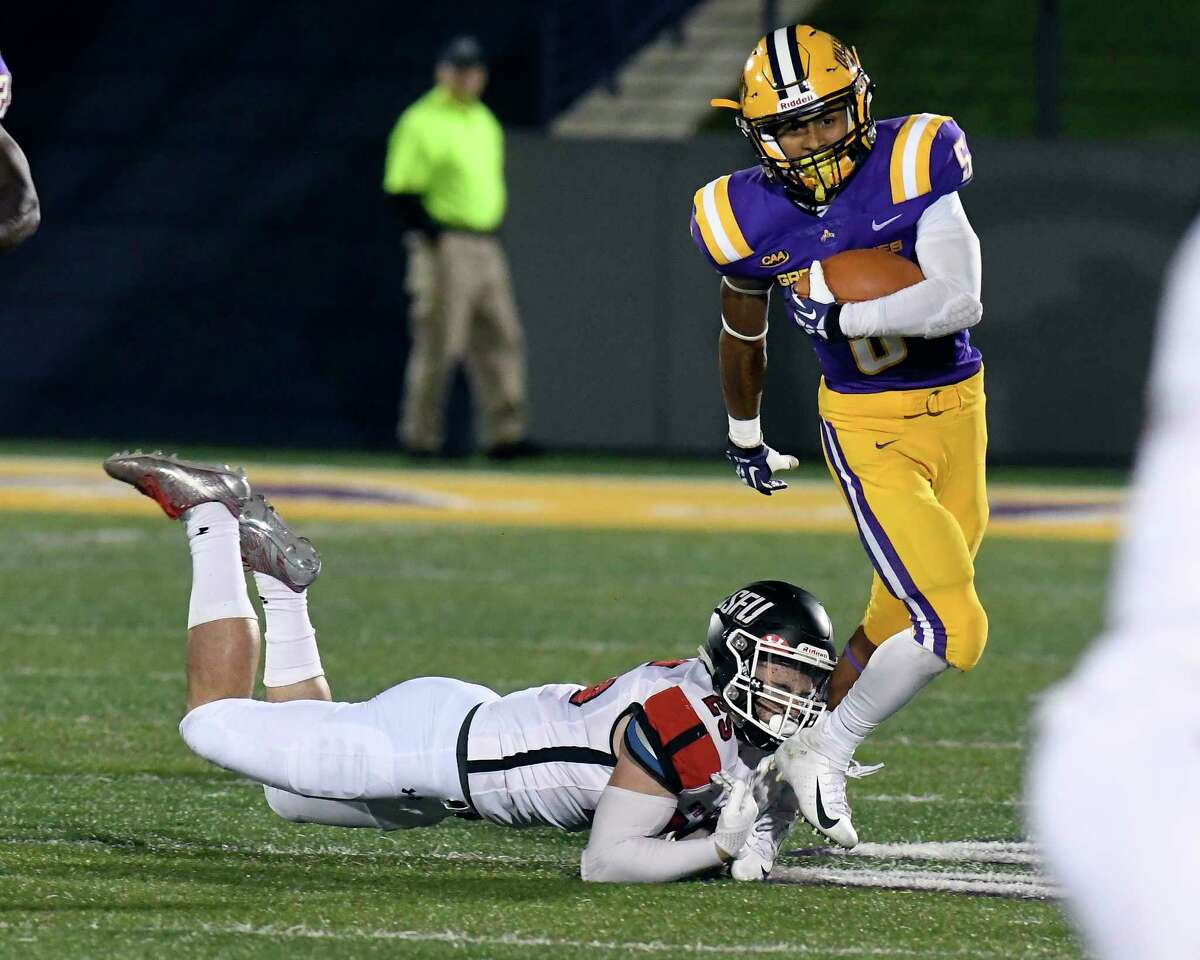 University at Albany wide receiver Dev Holmes (5) slips past St. Francis defensive back Nick Rinella (25) while running with the ball during the first half of an NCAA college football game Saturday, Sept. 22, 2018, in Albany, N.Y.