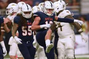 UTSA safety Andrew Martel celebrates after he put a hard hit on Texas State quarterback Tyler Vitt during college football action in the Alamodome on Saturday, Sept. 22, 2018.