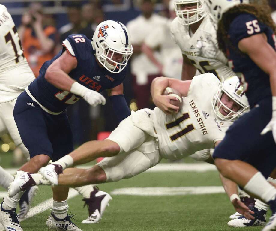 UTSA safety Andrew Martel (12) puts a hard hit on Texas State quarterback Tyler Vitt during college football action in the Alamodome on Saturday, Sept. 22, 2018. Photo: Billy Calzada / Staff Photographer / San Antonio Express-News