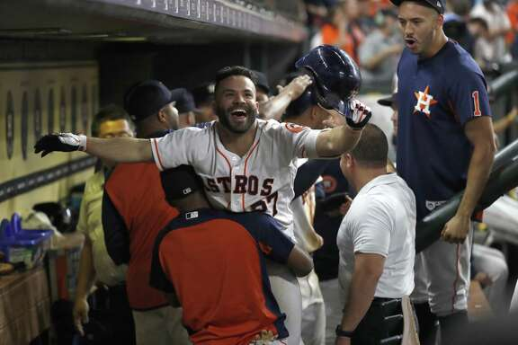 Jose Altuve celebrates capping the Astros' nine-run rally in the eighth inning with a two run homer Saturday night.
