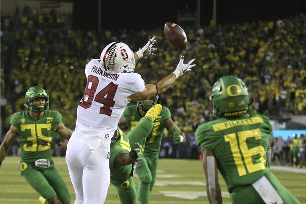 Stanford's Colby Parkinson, center, pulls down a touchdown pass in overtime against Oregon during NCAA college football game Saturday Sept. 22, 2018, in Eugene, Ore. (AP Photo/Chris Pietsch)