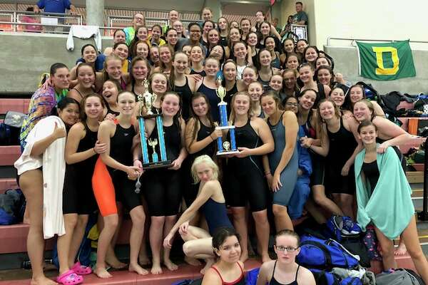 The Midland High and Dow High swimming and diving teams celebrate together after Dow finished first and Midland second at the Tri-Cities championships on Saturday at Saginaw Valley State University. (Photo provided)