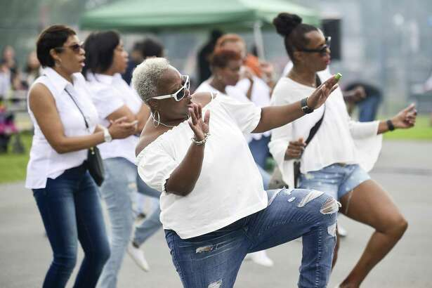Robin Cannon of Stamford and members of the Shining Starzz line dancers perform during the Waterside Diversity Festival at Boccuzzi Park in Stamford on Saturday.