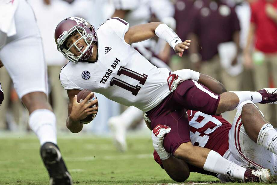 Texas A&M quarterback Kellen Mond is grabbed by Alabama's Isaiah Buggs for one of seven sacks Saturday. Photo: Wesley Hitt /Getty Images / 2018 Getty Images