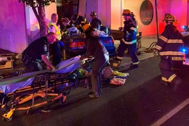 Two people were injured early Sunday morning in a three-car crash that sent one vehicle into a building in Ansonia.