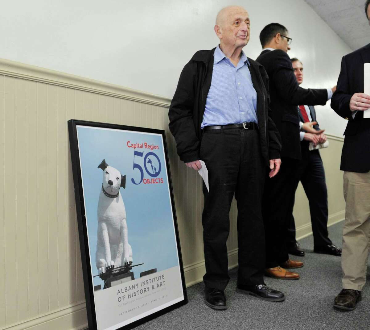 Harris Sanders stands next to an image of Nipper on top of the Arnoff building at 991 Broadway, as Sanders attended a press conference held by Senator Charles Schumer on Monday, April 25, 2016, in Albany, N.Y. Sanders passed away Sept. 18 (Paul Buckowski / Times Union)