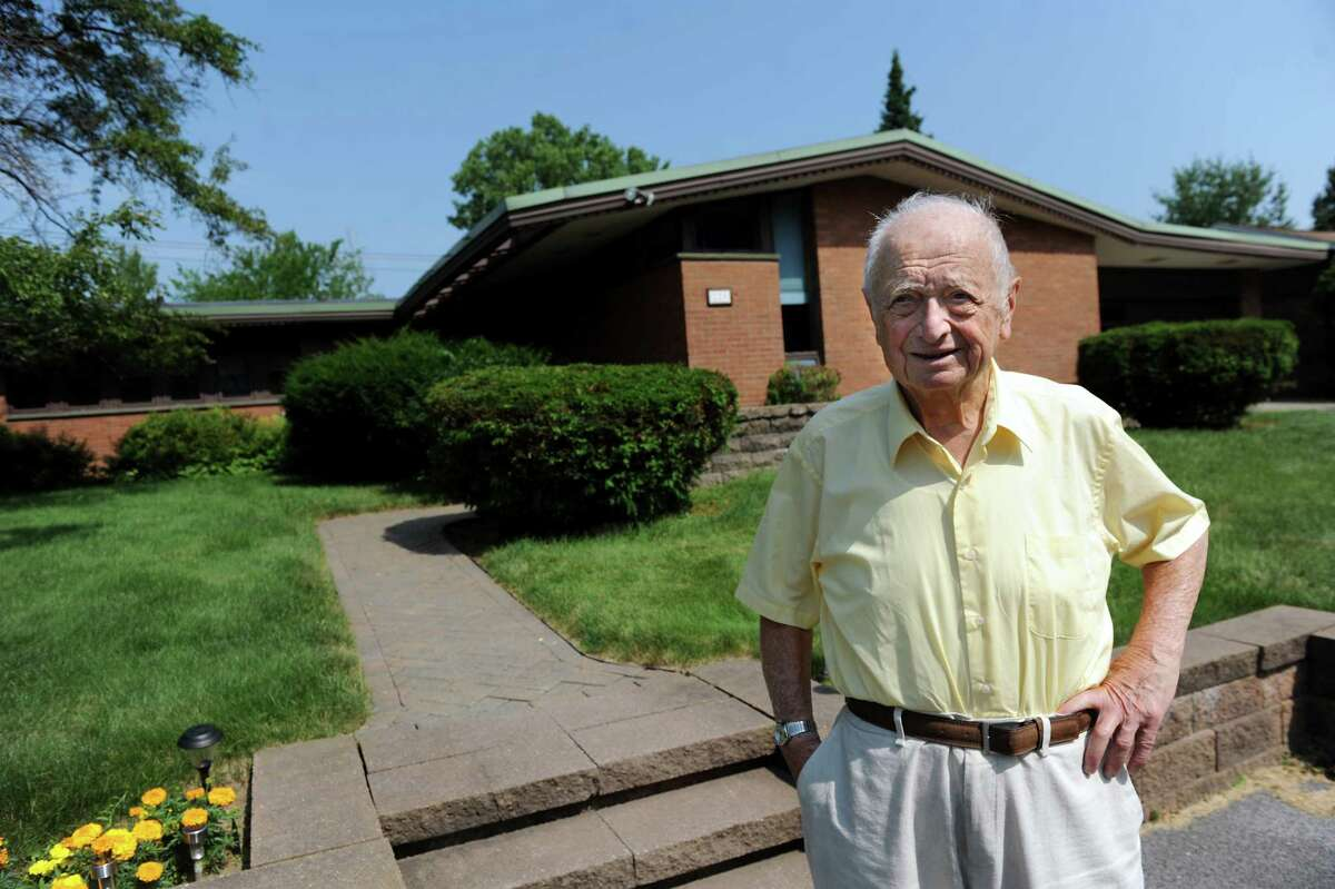 Albany architect Harris Sanders stands in front of his home, which he designed, on Wednesday July 2, 2014, in Albany, N.Y. (Cindy Schultz / Times Union)