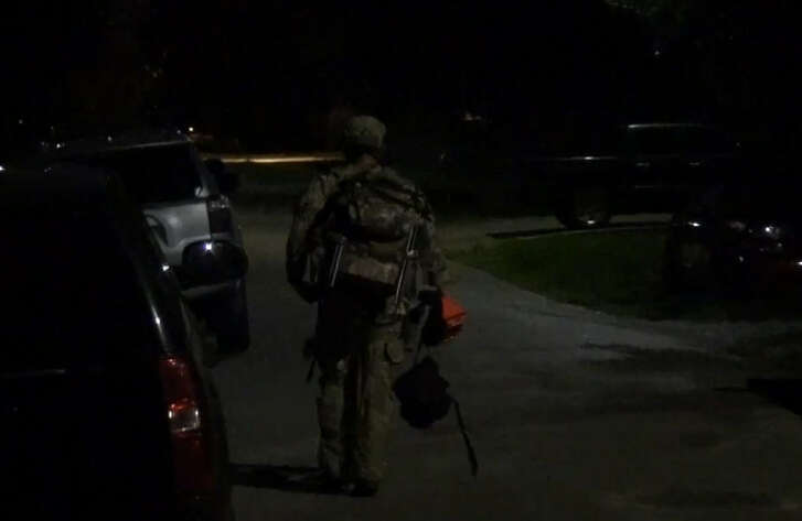 Men firing dozens of shots outside sparked a police standoff early Sunday.