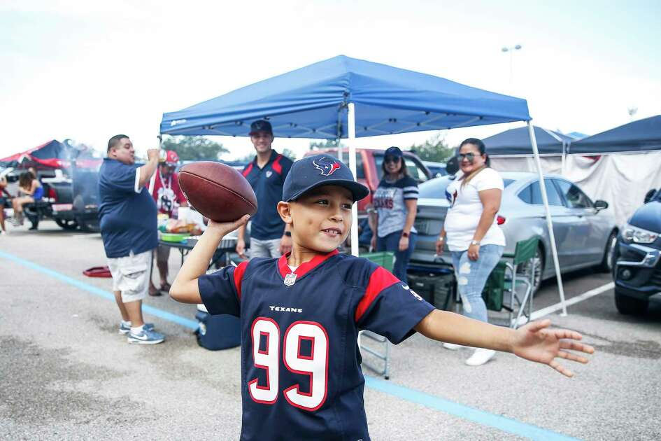 Jayden Flores, 7, throws a football before the Houston Texans take on the New York Giants at NRG Stadium Sunday Sept. 23, 2018 in Houston.