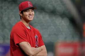 Los Angeles Angels' Shohei Ohtani, of Japan, waits to stretch during batting practice before a baseball game against the Houston Astros Friday, Sept. 21, 2018, in Houston. (AP Photo/David J. Phillip)