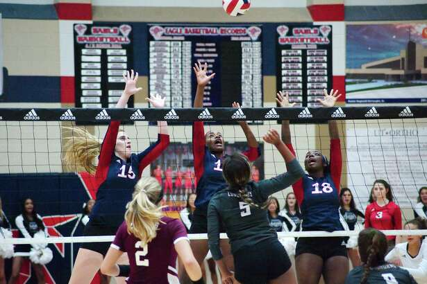 Dawson's Madison Deslatte (15), Alexia Jones (11) and Kaitlyn Scroggins (18) put up a wall at the net against George Ranch Tuesday in a District 23-6A volleyball match.