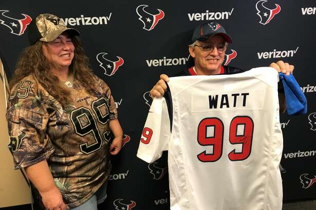 Donald Stampley shows off the autographed jersey he got from J.J. Watt before Sunday's Texans game against the New York Giants. Stampley suffered a heart attack during a Texans preseason game and received treatment in the stands.