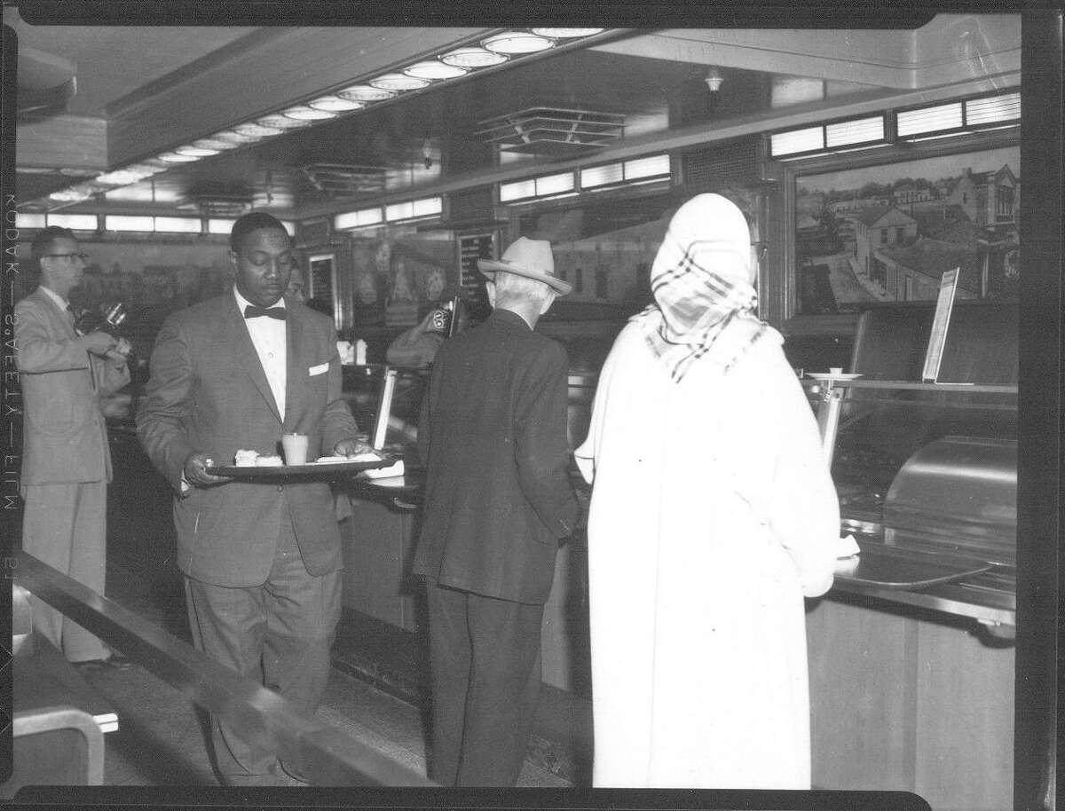 This photo from March 16, 1960, shows the racial integration of a lunch counter in downtown San Antonio. That day about seven stores, including the F.W. Woolworth store on Alamo Plaza, allowed black customers to be seated next to white customers. In San Antonio, integration happened peacefully, unlike some cities elsewhere.