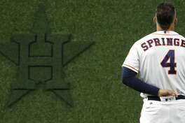 Houston Astros George Springer (4) during the National Anthem before the start of an MLB baseball game at Minute Maid Park, Wednesday, September 19, 2018, in Houston.