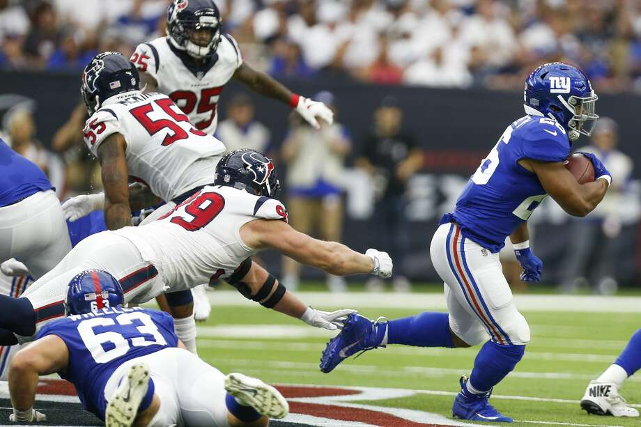 New York Giants running back Saquon Barkley (26) breaks away from the Houston Texans defense for a run during the first half as the Houston Texans take on the New York Giants at NRG Stadium Sunday Sept. 23, 2018 in Houston. Photo: Michael Ciaglo/Staff Photographer
