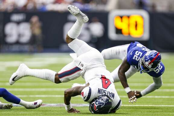 Houston Texans quarterback Deshaun Watson (4) is tackled by New York Giants cornerback Donte' Deayon (38) andm linebacker Alec Ogletree (52) during the first half as the Houston Texans take on the New York Giants at NRG Stadium Sunday Sept. 23, 2018 in Houston.