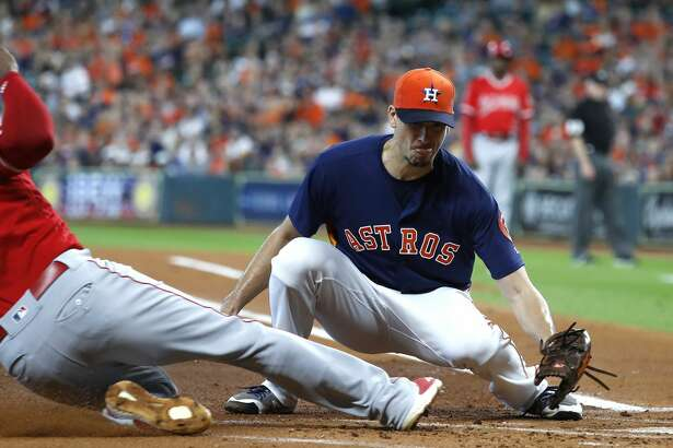 Houston Astros starting pitcher Charlie Morton (50) tries ot tag Los Angeles Angels Justin Upton (8) out at home during the first inning of an MLB baseball game at Minute Maid Park, Sunday, September 23, 2018, in Houston.
