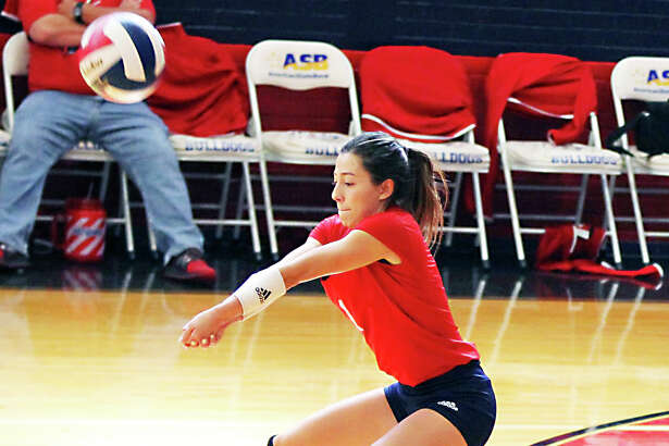 Plainview Lady Bulldogs senior libero Julissa Chavez returns a hit during the District 3-5A contest against the Coronado Lady Mustangs on Saturday in Plainview. The Lady Mustangs beat the Lady Bulldogs, 3-0.