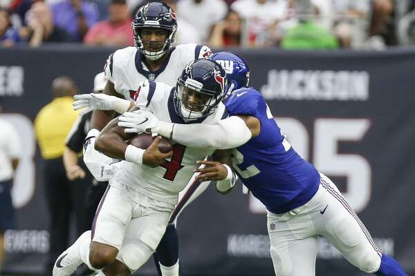Houston Texans quarterback Deshaun Watson (4) is tackled by New York Giants defensive end Kerry Wynn (72) during the first half as the Houston Texans take on the New York Giants at NRG Stadium Sunday Sept. 23, 2018 in Houston.