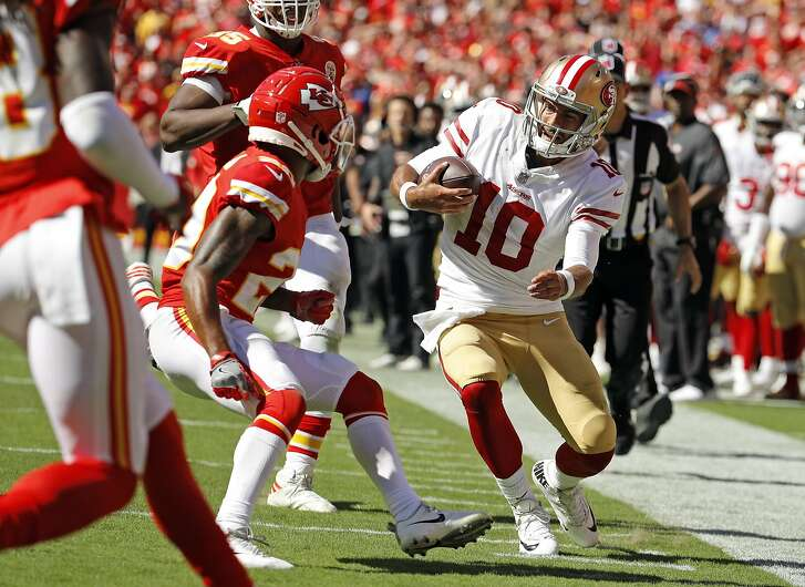 Kansas City Chiefs defensive back Steven Nelson (20) closes in to tackle San Francisco 49ers quarterback Jimmy Garoppolo (10), right, during the second half of an NFL football game in Kansas City, Mo., Sunday, Sept. 23, 2018. Garoppolo was injured on the play. (AP Photo/Charlie Riedel)