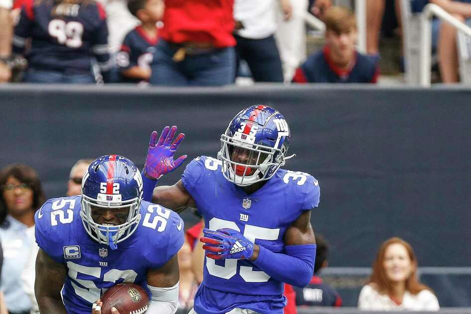 New York Giants linebacker Alec Ogletree (52) celebrates an interception in the end zone during the second half as the Houston Texans take on the New York Giants at NRG Stadium Sunday Sept. 23, 2018 in Houston.