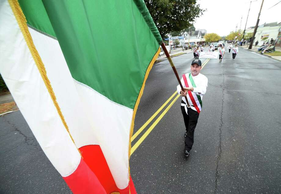 Paul Frosolone, president of the West Haven Italian American Club, carries the Italian flag up Campbell Ave. during the Greater New Haven Columbus Day Parade in West Haven on October 8, 2017. Photo: Arnold Gold / Hearst Connecticut Media / New Haven Register