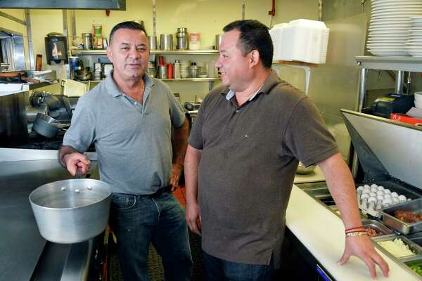 El Salvadorian immigrants and co owners Adan Lemus, left, and Wilfredo Ruiz in the kitchen of Jack's Diner on Central Avenue Friday Sept. 21, 2018 in Albany, NY. (John Carl D'Annibale/Times Union)