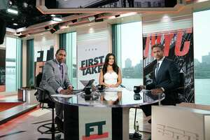 ESPN anchor Molly Qerim, center, on the set of First Take with Stephen A. Smith, left, and Max Kellerman.