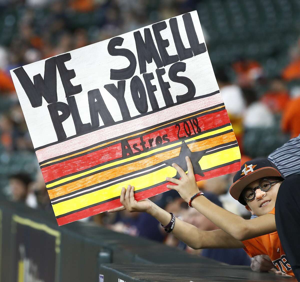 A Houston Astros fan holds up a