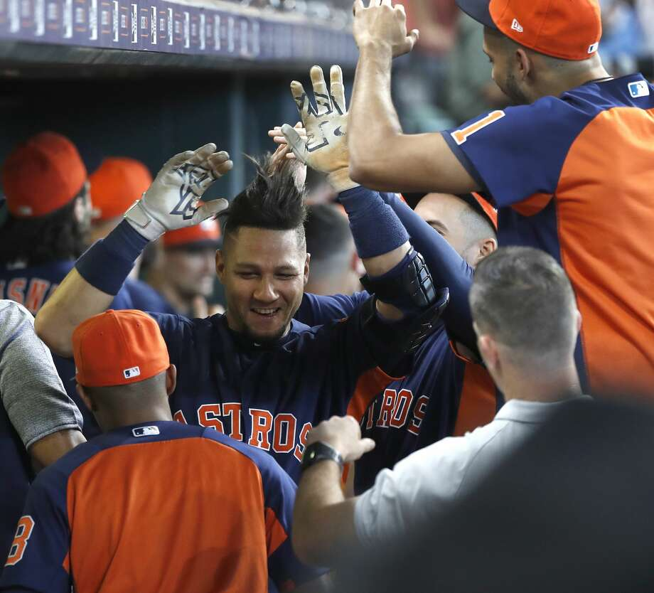 Houston Astros Yuli Gurriel (10) celebrates his home run with teammates in the dugout during the first inning of an MLB baseball game at Minute Maid Park, Sunday, September 23, 2018, in Houston. Photo: Karen Warren/Staff Photographer
