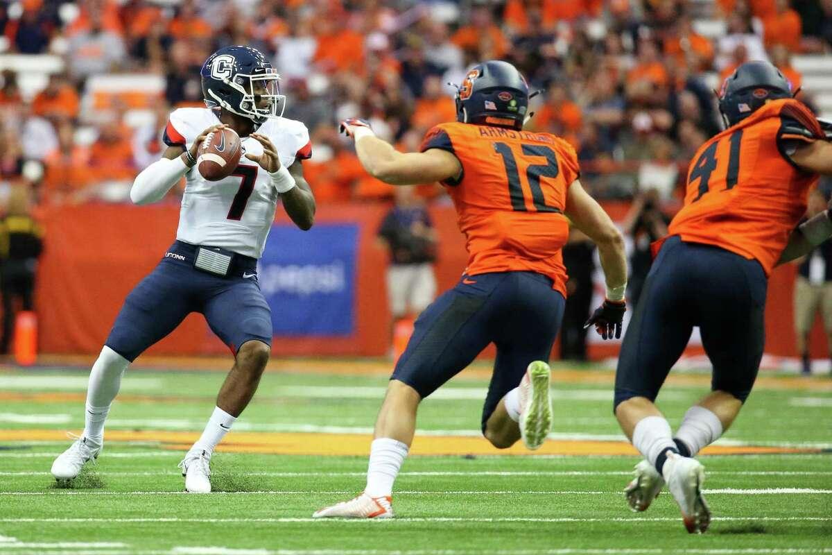 UConn redshirt freshman quarterback Marvin Washington (7) drops back to pass against Syracuse on Saturday.