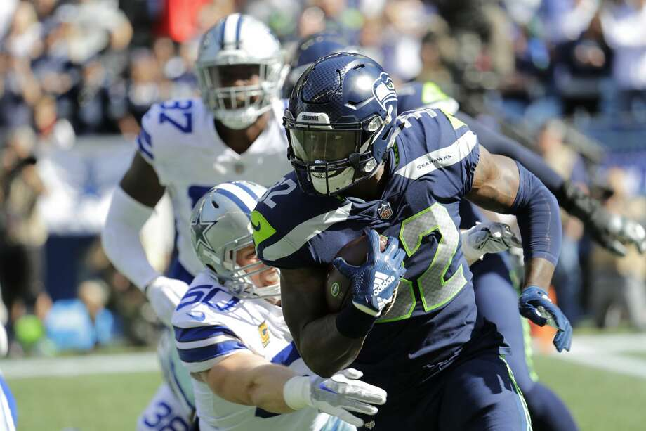 In the Seahawks' win over the Cowboys last week, Chris Carson had the first 100-yard rushing game for a Seahawk tailback since 2016. He also became the first Seahawk running back to record a rushing TD since Week 4 of last year. Photo: Elaine Thompson/AP