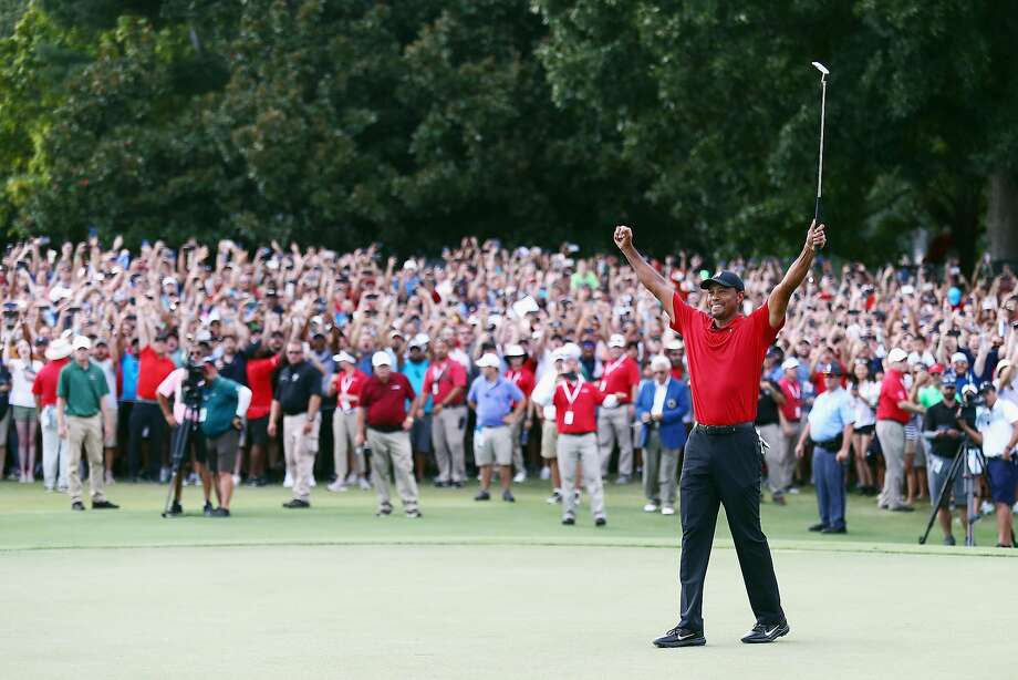 ATLANTA, GA - SEPTEMBER 23:  Tiger Woods of the United States celebrates making a par on the 18th green to win the TOUR Championship at East Lake Golf Club on September 23, 2018 in Atlanta, Georgia.  (Photo by Tim Bradbury/Getty Images) Photo: Tim Bradbury / Getty Images