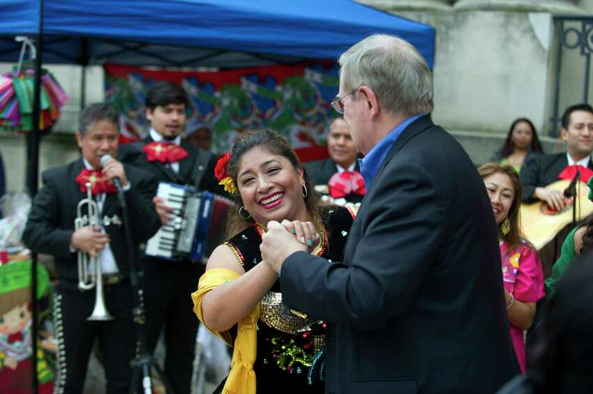 Pilar Blanco dances with Stamford mayor David Martin as the Mariachi Citlalli band play during the Hispanic Heritage Month celebration outside Old Town Hall in downtown Stamford, Conn. on Sunday, Sept. 23, 2018. The celebration, organized by the Latino Foundation of Stamford, included the raising of the Mexican flag and celebrated the 208th anniversary of Mexican independence.