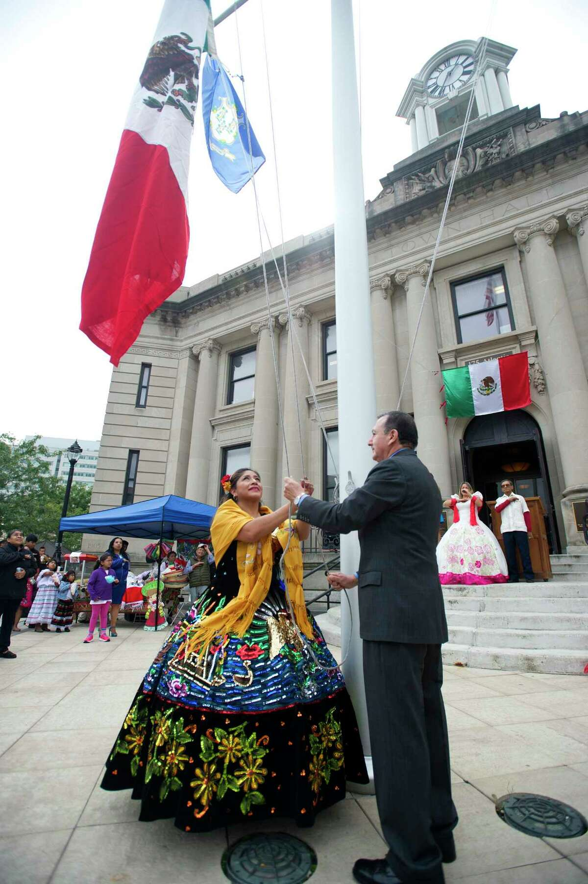 Pilar Blanco, left, and Rene Telez raise the Mexican flag during the Hispanic Heritage Month celebration outside Old Town Hall in downtown Stamford, Conn. on Sunday, Sept. 23, 2018. The celebration, organized by the Latino Foundation of Stamford, included the raising of the Mexican flag and celebrated the 208th anniversary of Mexican independence.