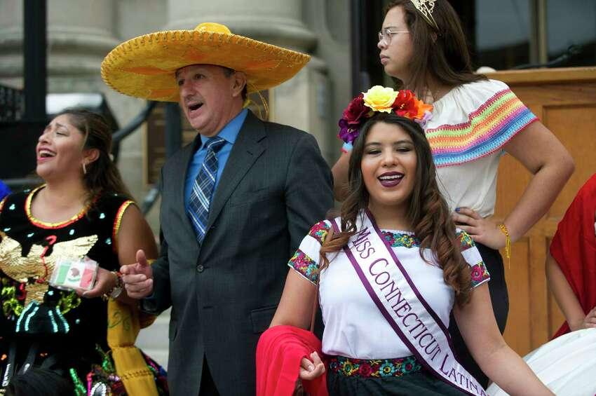 Miss Connecticut Lation Paulet Cortes, of Ridgefield, sings and dances as the Mariachi Citlalli band play during the Hispanic Heritage Month celebration outside Old Town Hall in downtown Stamford, Conn. on Sunday, Sept. 23, 2018. The celebration, organized by the Latino Foundation of Stamford, included the raising of the Mexican flag and celebrated the 208th anniversary of Mexican independence.