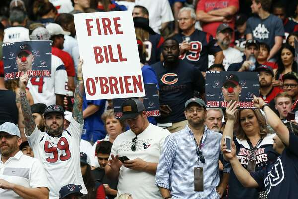 "A Houston Texans fan holds up a ""Fire Bill O'Brien"" sign during the second quarter of the Texans 27-22 loss to the New York Giants at NRG Stadium on Sunday, Sept. 23, 2018, in Houston."