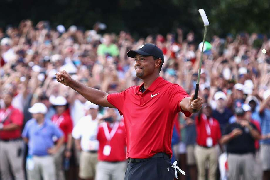 ATLANTA, GA - SEPTEMBER 23:  Tiger Woods of the United States celebrates making a par on the 18th green to win the TOUR Championship at East Lake Golf Club on September 23, 2018 in Atlanta, Georgia.  (Photo by Tim Bradbury/Getty Images) Photo: Tim Bradbury, Getty Images