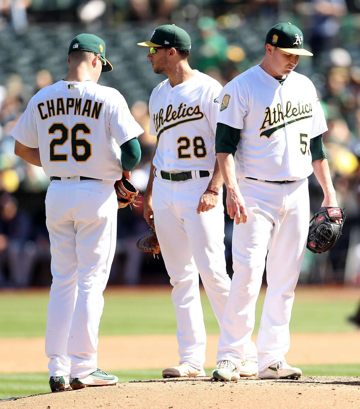 Oakland Athletics' starting pitcher Trevor Cahill waits to be removed during Minnesota Twins' 3-run 4th inning during MLB game at Oakland Coliseum in Oakland, Calif. on Sunday, September 23, 2018.