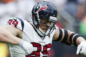 Houston Texans defensive end J.J. Watt (99) celebrates after he sacked New York Giants quarterback Eli Manning during the third quarter of an NFL football game at NRG Stadium on Sunday, Sept. 23, 2018, in Houston.