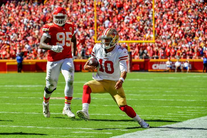 KANSAS CITY, MO - SEPTEMBER 23: Jimmy Garoppolo #10 of the San Francisco 49ers rushes plants on his left leg at the sideline on a play in which he would be injured during the fourth quarter of the game against the Kansas City Chiefs at Arrowhead Stadium on September 23rd, 2018 in Kansas City, Missouri. (Photo by Peter Aiken/Getty Images)