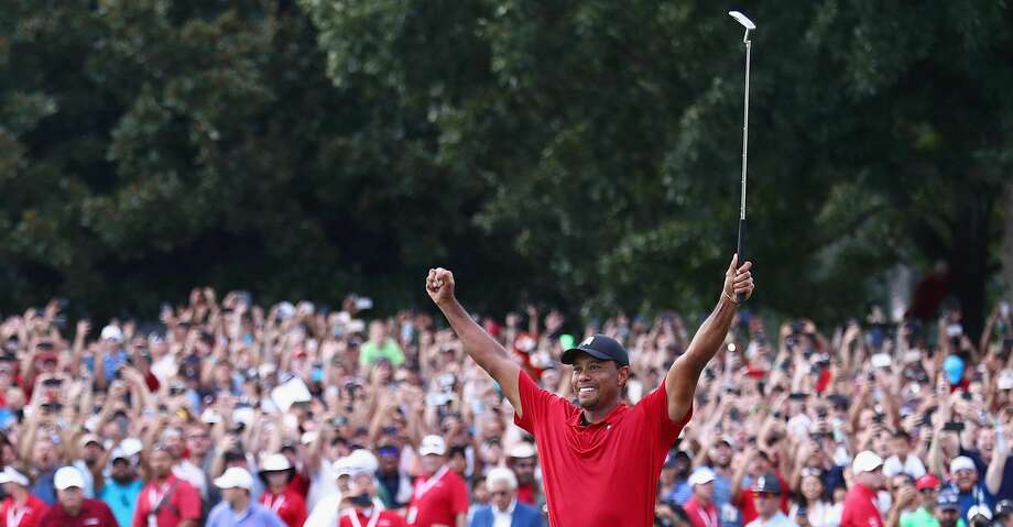 ATLANTA, GA - SEPTEMBER 23:  Tiger Woods of the United States celebrates making a par on the 18th green to win the TOUR Championship at East Lake Golf Club on September 23, 2018 in Atlanta, Georgia.  (Photo by Tim Bradbury/Getty Images) Photo: Tim Bradbury/Getty Images