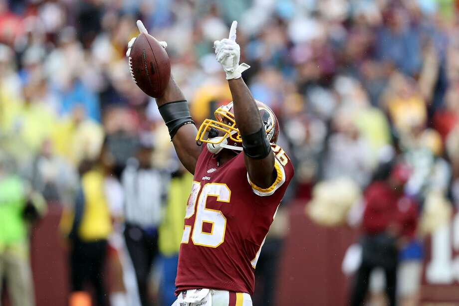Adrian Peterson celebrates after scoring his 101st rushing TDa first-half TD, which moved him past Marshall Faullk and Shaun Alexander. He passed touchdown against the Green Bay Packers at FedExField on September 23, 2018 in Landover, Maryland. (Photo by Rob Carr/Getty Images) Photo: Rob Carr / Getty Images