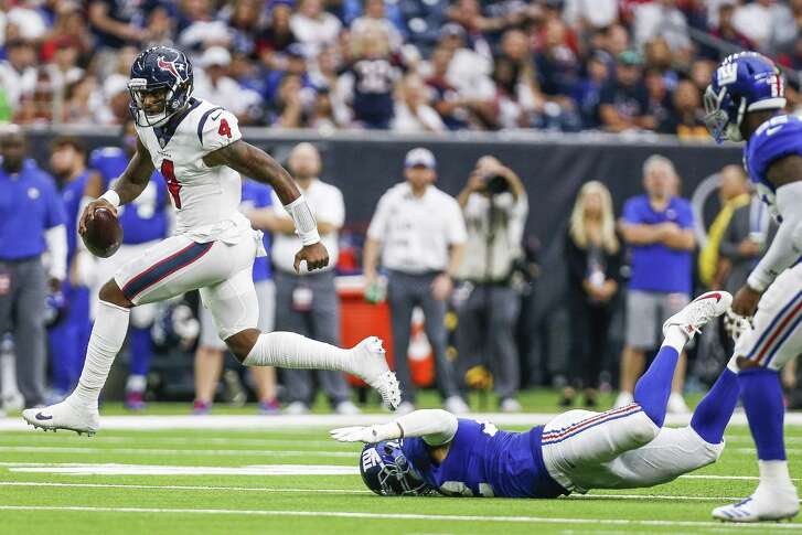 Houston Texans quarterback Deshaun Watson (4) runs past a tackle New York Giants defensive end Kerry Wynn (72) during the first half as the Houston Texans take on the New York Giants at NRG Stadium Sunday Sept. 23, 2018 in Houston.