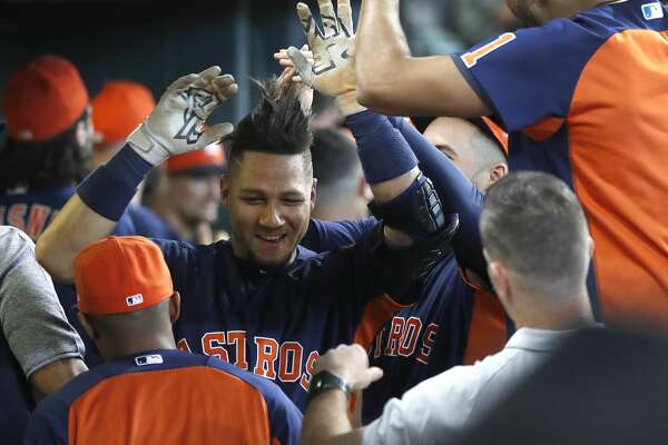 Houston Astros Yuli Gurriel (10) celebrates his home run with teammates in the dugout during the first inning of an MLB baseball game at Minute Maid Park, Sunday, September 23, 2018, in Houston.