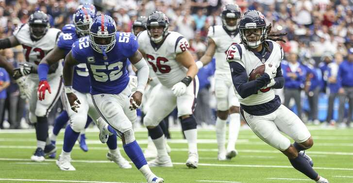 Houston Texans wide receiver Will Fuller (15) runs the ball in for a touchdown during the second half as the Houston Texans take on the New York Giants at NRG Stadium Sunday Sept. 23, 2018 in Houston.