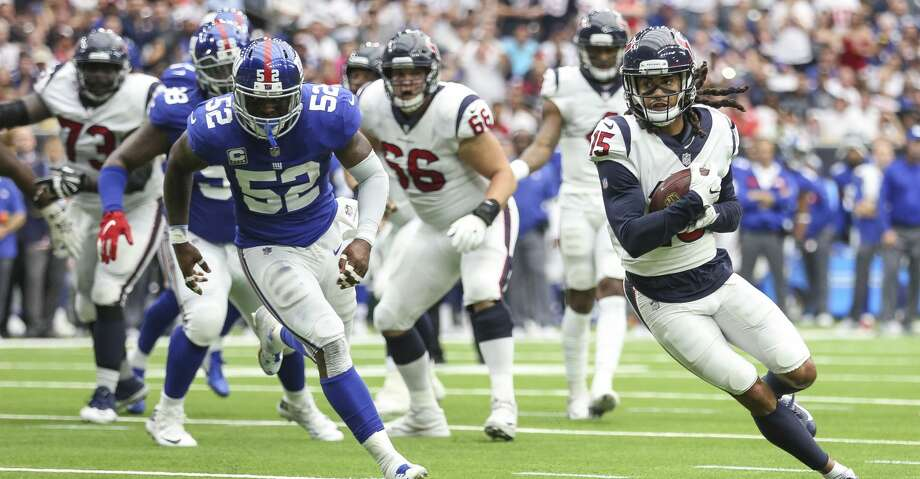 PHOTOS: Texans vs. Giants Houston Texans wide receiver Will Fuller (15) runs the ball in for a touchdown during the second half as the Houston Texans take on the New York Giants at NRG Stadium Sunday Sept. 23, 2018 in Houston. Browse through the photos to see action from the Texans' home opener against the Giants. Photo: Michael Ciaglo/Staff Photographer